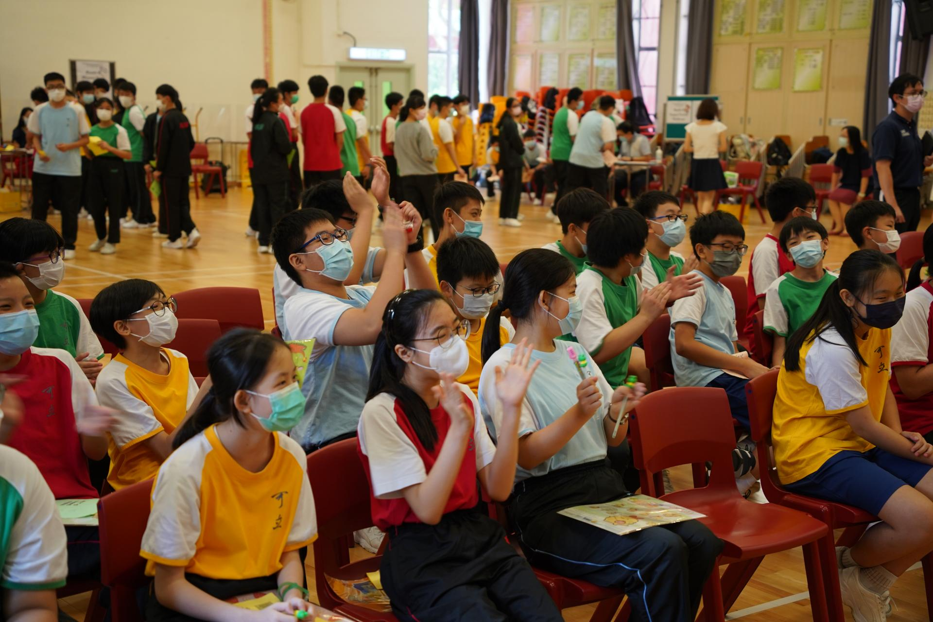 Students cheered for their classmates excitedly